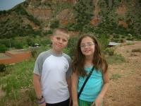 Sarah & Derek at the peak of mountain in Palo Duro
